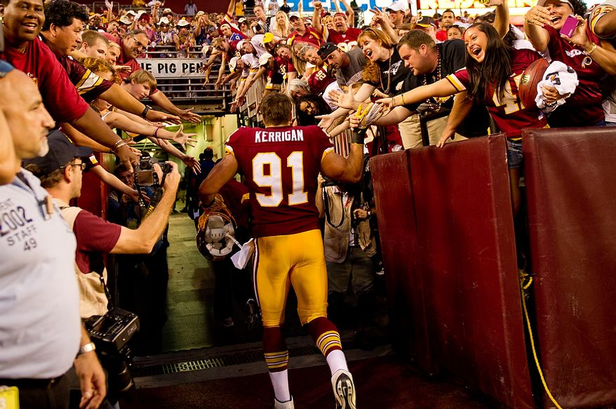 Washington Redskins LB Ryan Kerrigan (91) celebrates a win over the New York Giants with Redskins fans after the game at FedEx Field in Landover, Md. Sunday, September 11, 2011. (Andrew Harnik / The Washington Times)