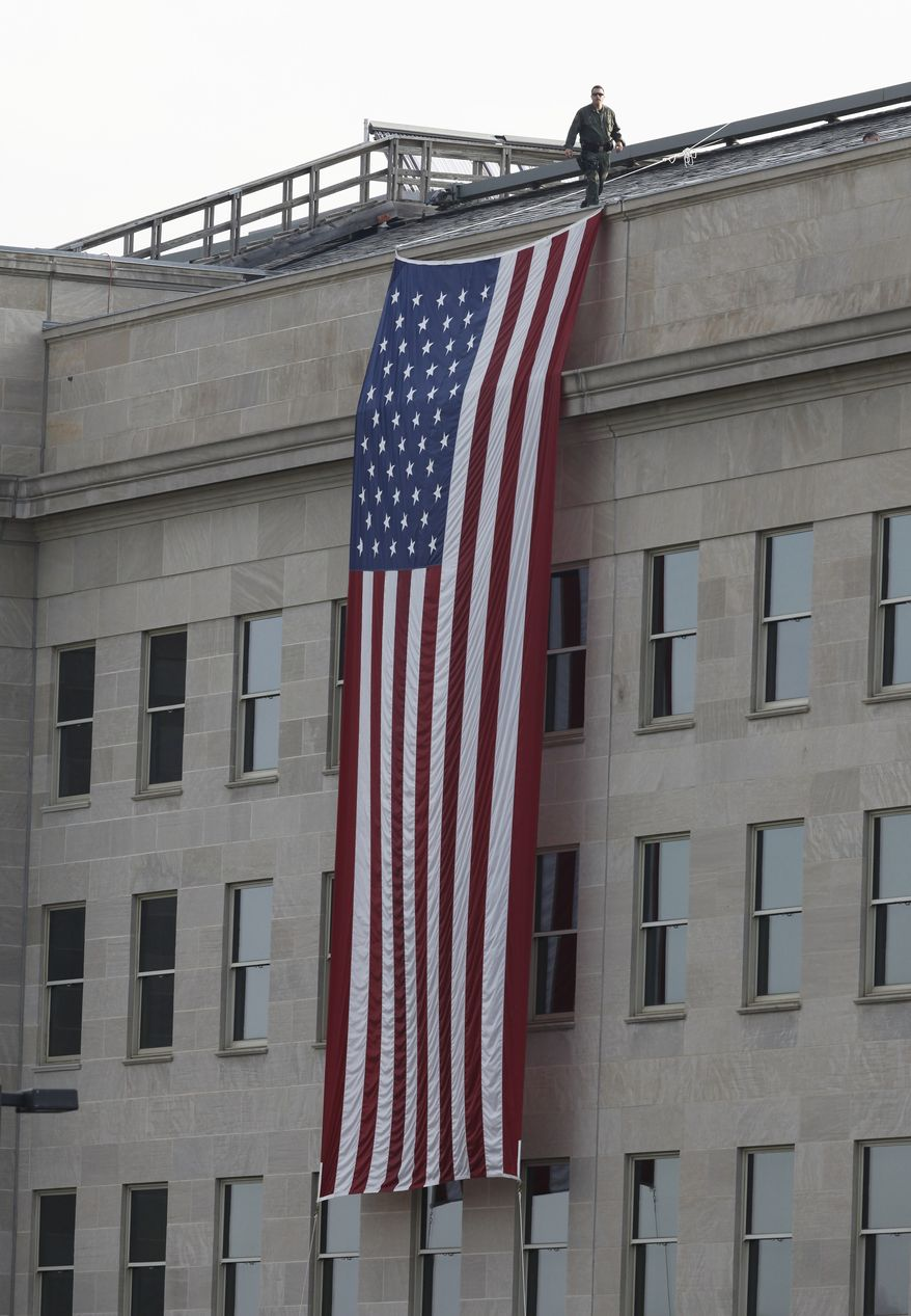 ** FILE ** A security officer walks on the roof of the Pentagon. (AP Photo/Charles Dharapak)
