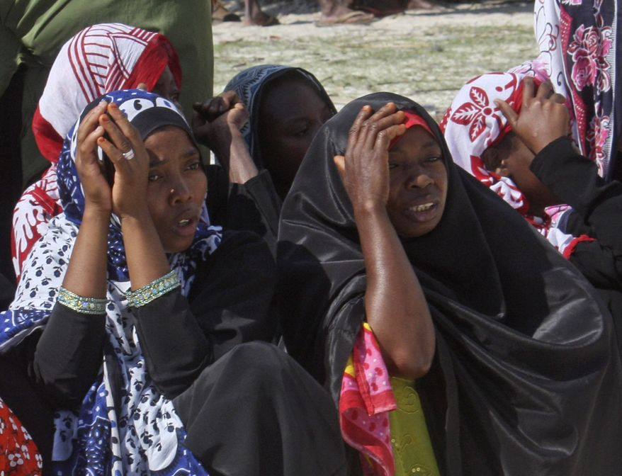 Women mourn the dead in Zanzibar, Tanzania, on Sunday, Sept 11, 2011, after the ferry M.V. Spice Islanders sank early Saturday near the tourist destination of Zanzibar. (AP Photo/Ali Sultan)