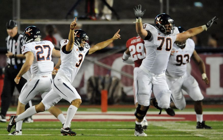 Virginia Cavaliers kicker Robert Randolph (3) and Virginia Cavaliers guard Luke Bowanko (70) celebrate after Randolph kicked the game-winning field goal as time expired during an NCAA college football game against Indiana at Memorial Stadium in Bloomington, Ind., Saturday, Sept. 10, 2011. Virginia scored 11 points in the final 96 seconds to win 34-31. (AP Photo/The Herald-Times, Chris Howell)