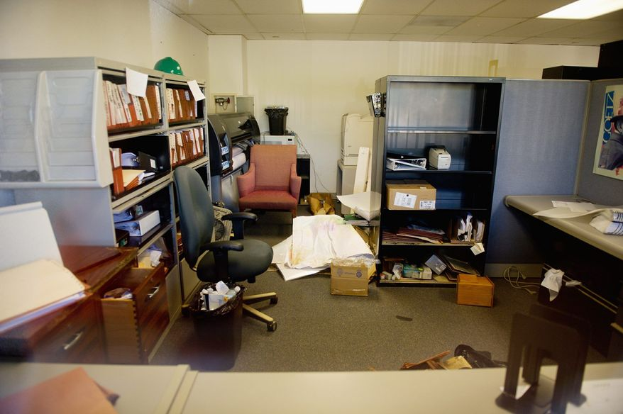 An office on the lower level of the closed Prince George's County Administration Building shows items in disarray after last week's storms caused water damage from flooding. (Andrew Harnik/The Washington Times)