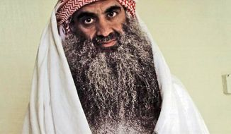 This July 2009 photo from the Arabic-language website www.muslm.net shows a man it identifies as Khalid Shaikh Mohammed in detention at U.S. Naval Base Guantanamo Bay, Cuba. (www.muslm.net via Associated Press)