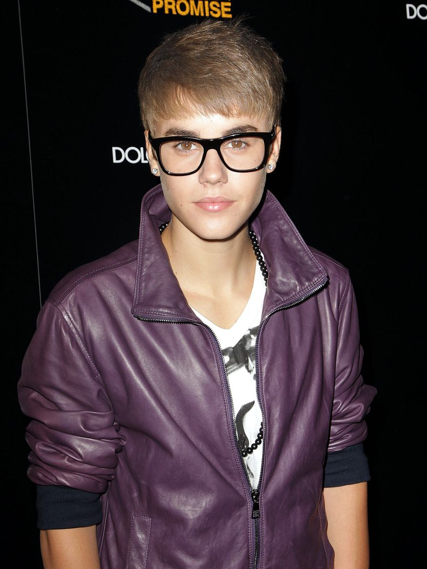 Singer Justin Bieber attends the Fashion Night Out Dolce & Gabbana at the Dolce & Gabbana store on Madison & 69th street on Thursday, Sept. 8, 2011. (AP Photo/Donald Traill)
