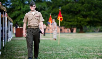 By day, rap artist Derek Meitzer, aka D'Meitz, is Lance Cpl. Meitzer, currently stationed at Marine Corps Base Quantico in Virginia. (Pratik Shah/The Washington Times)