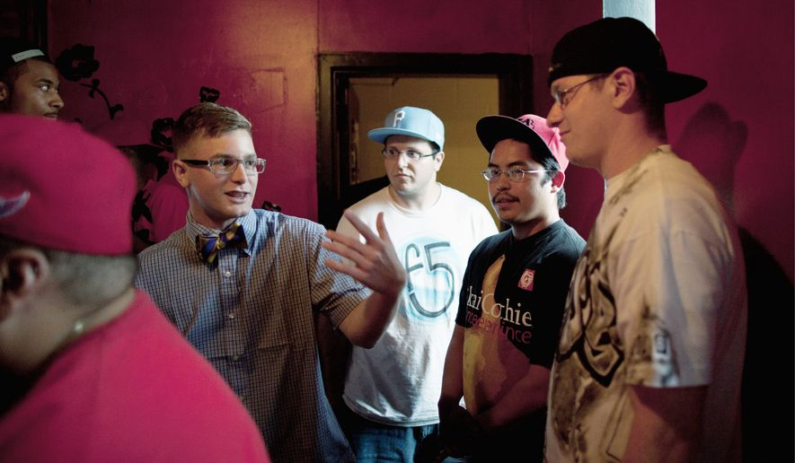 Derek Meitzer, aka D'Meitz (left), freestyles with friends before a rap battle competition at Studio Braat in D.C. By day, the rap artist is Lance Cpl. Meitzer, currently stationed at Marine Corps Base Quantico in Virginia. (Pratik Shah/The Washington Times)