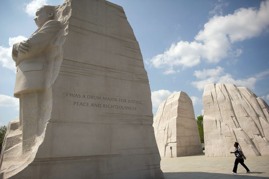 The dedication of the Martin Luther King Jr. National Memorial, postponed in August because of Hurricane Irene, has been rescheduled for Oct. 16. D.C.-rights advocates will use the occasion to hold a rally and march. (Rod Lamkey Jr./The Washington Times)