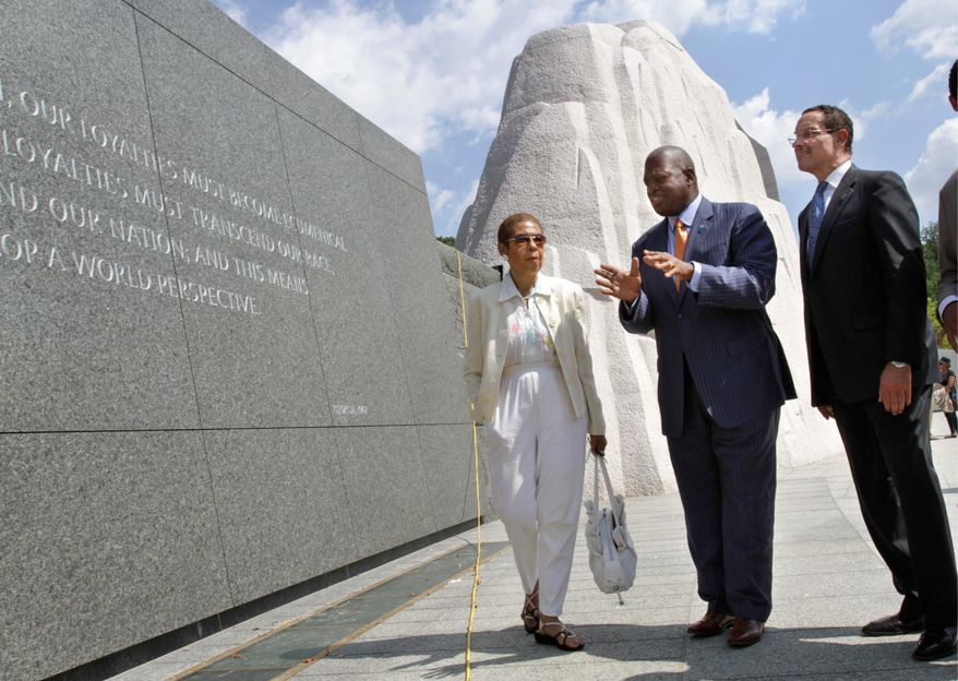 D.C. Delegate Eleanor Holmes Norton walks with Harry E. Johnson, president/CEO of the Martin Luther King, Jr. Memorial Foundation (center), and D.C. Mayor Vincent C. Gray, at the King memorial on the Mall. (Associated Press)