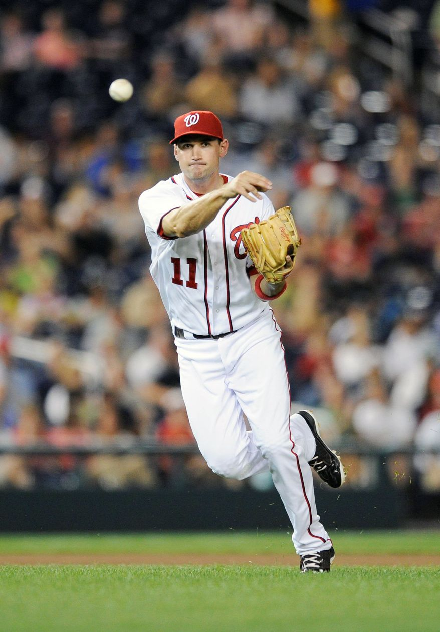 Nationals third baseman Ryan Zimmerman changed his throwing motion after having surgery for a torn abdominal muscle. (Associated Press)
