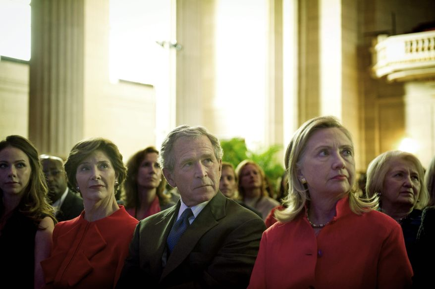 Former President George W. Bush is joined by Barbara Bush, his daughter; Laura Bush, his wife and the former first lady; and Secretary of State Hillary Rodham Clinton before his speech in Washington on Tuesday about a new initiative to combat cancers in women in developing countries. The program aims to expand the services of clinics created under the President's Emergency Plan for AIDS Relief. (Rod Lamkey Jr./The Washington Times)