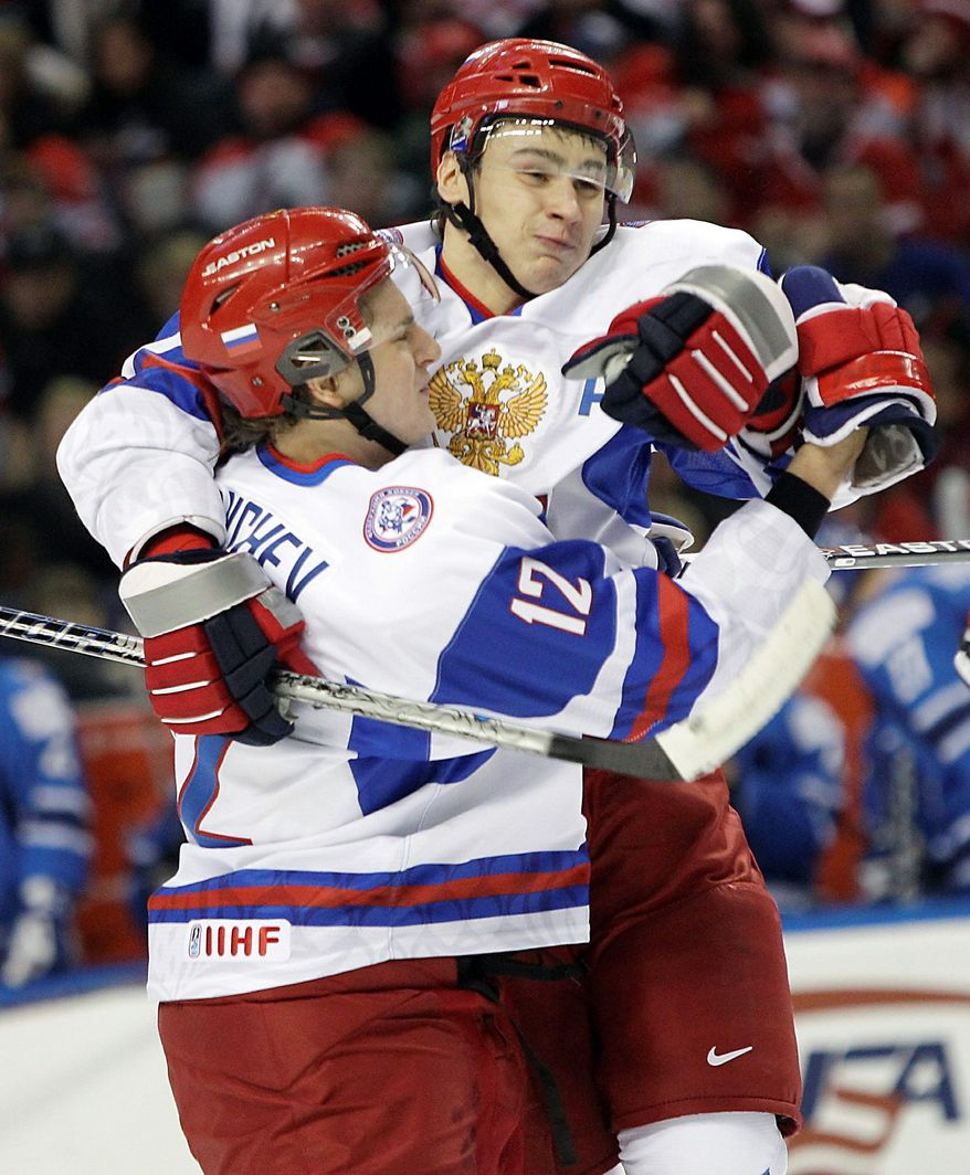 Defenseman Dmitry Orlov (right) , a 20-year-old prospect in the Capitals organization, celebrates a goal for Russia during the World Junior Hockey Championship in January. (Associated Press)