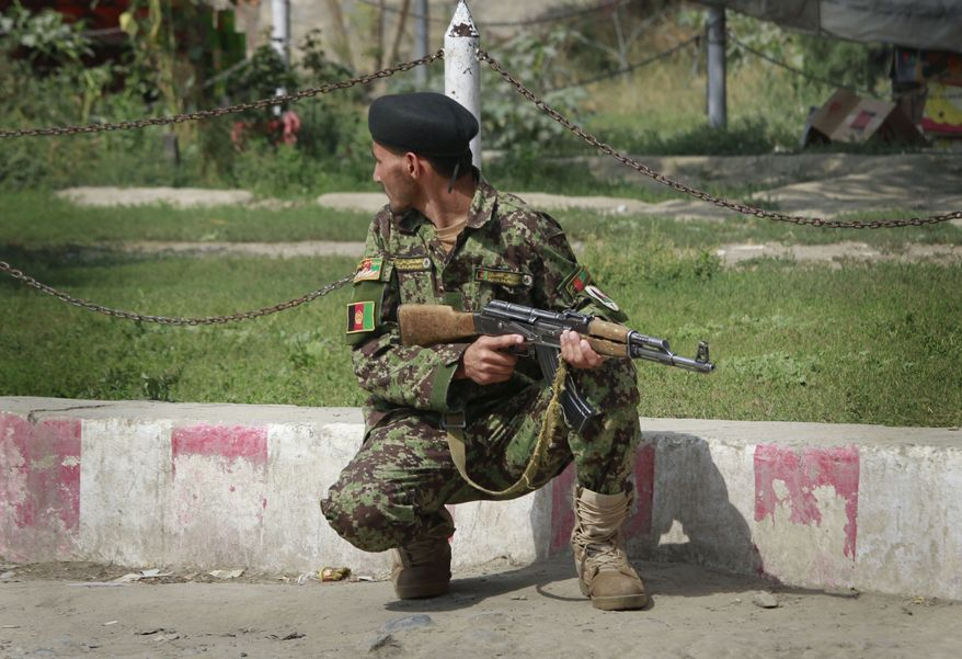 An Afghan soldier takes position near the building which is occupied by militants in Kabul, Afghanistan, on Sept. 13, 2011. Taliban insurgents fired rocket-propelled grenades and assault rifles at the U.S. Embassy, NATO headquarters and other buildings in the heart of the Afghan capital Tuesday in a brazen attack two days after the United States marked the 10th anniversary of the Sept. 11 terror attacks. (Associated Press)