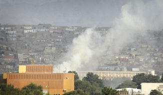 **FILE** Dust rises over Kabul, Afghanistan, on Sept. 13, 2011, as Taliban insurgents fire rocket-propelled grenades and assault rifles at the U.S. Embassy, NATO headquarters and other buildings in the heart of the Afghan capital. (Associated Press)
