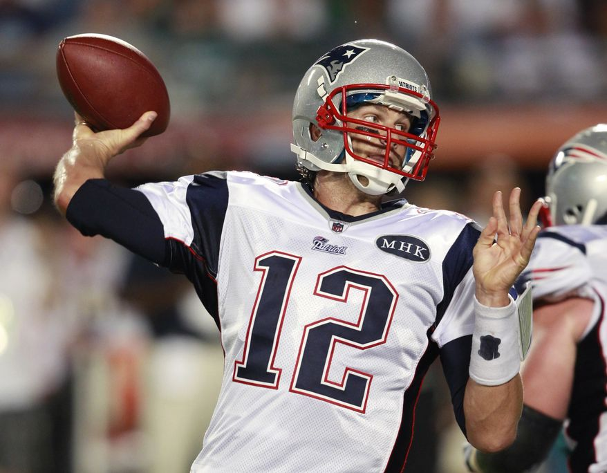 New England Patriots quarterback Tom Brady throws during the first half of an NFL football game against the Miami Dolphins, Monday, Sept. 12, 2011, in Miami. Brady threw for a team-record 517 yards and four TDs as the Patriots won 38-24. (AP Photo/Wilfredo Lee)