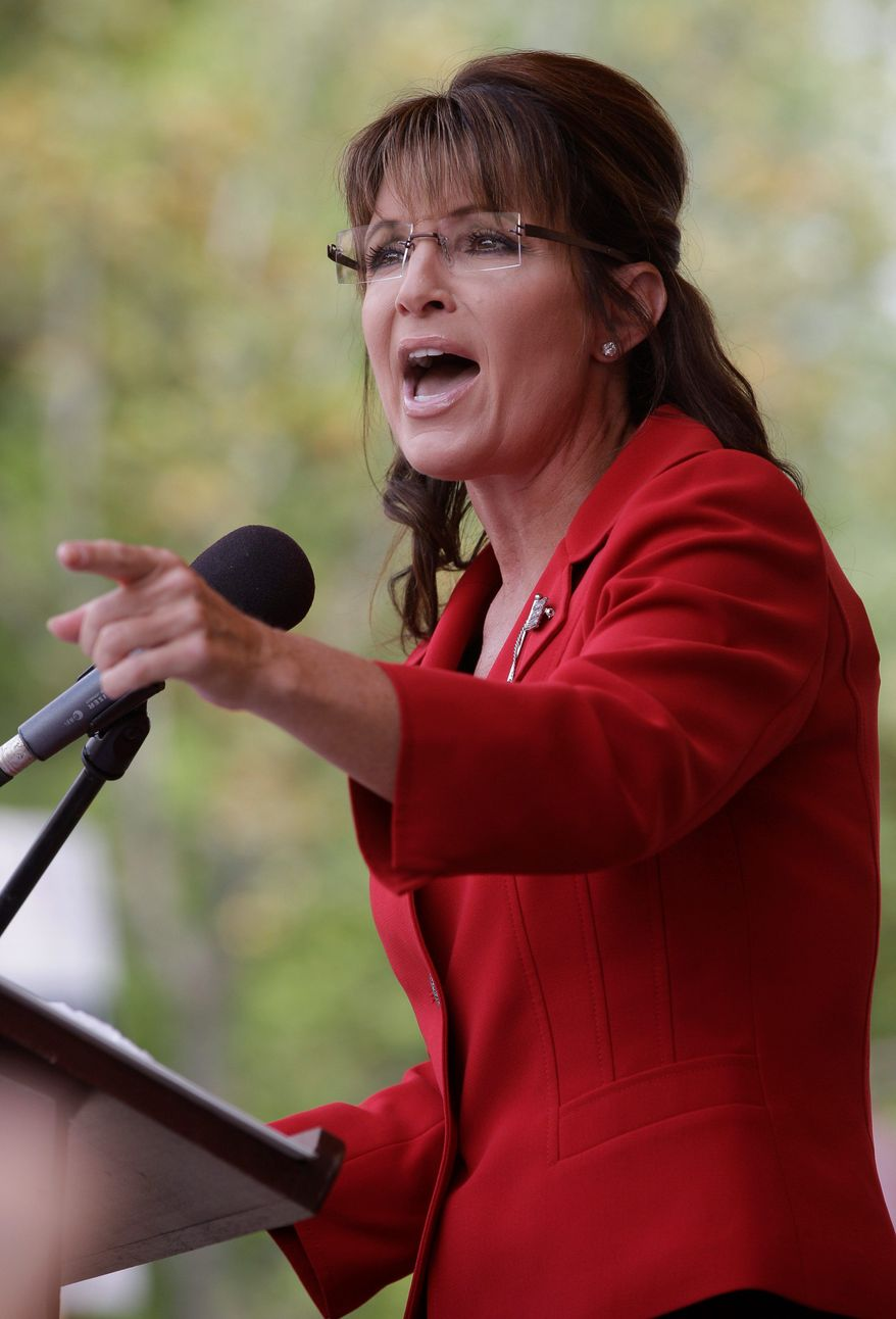 Former vice presidential candidate and Alaska Gov. Sarah Palin addresses a Tea Party Express Rally in Manchester, N.H., Monday afternoon, Sept. 5, 2011. Palin left open the possibility of a presidential bid Monday afternoon, while encouraging tea party activists to unite against President Obama. (AP Photo/Stephan Savoia)