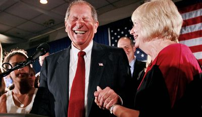 Republican Bob Turner celebrates his victory in the special congressional election in New York City on Tuesday night with his wife, Peggy. Mr. Turner won a seat that was in Democratic hands since 1920. (Associated Press)