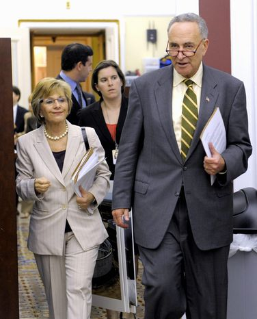 Democratic Sens. Charles E. Schumer of New York and Barbara Boxer of California arrive Thursday to speak to reporters about legislation funding the Federal Aviation Administration. (Associated Press)