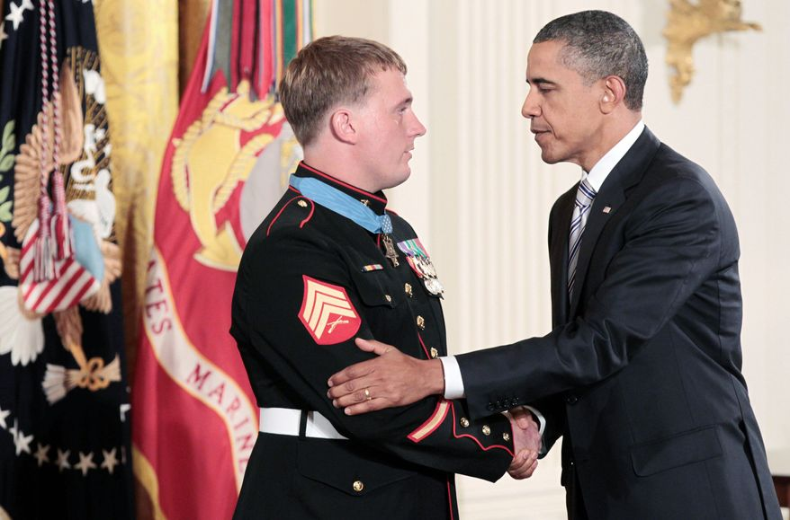 President Obama shakes the hand of former Marine Corps Sgt. Dakota Meyer, 23, after awarding him the Medal of Honor. The Kentucky resident was in Afghanistan's Kunar province in September 2009 when he killed at least eight Taliban insurgents, rescuing 36 fellow soldiers from an ambush. (Associated Press)