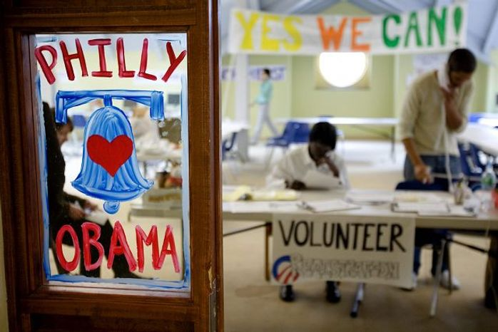 **FILE** A hand-painted sign greets visitors to the Philadelphia office of then-Sen. Barack Obama's presidential campaign on March 5, 2008. (Associated Press)