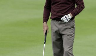 Mark Wilson reacts after his second shot on the 18th hole during the second round at the BMW Championship golf tournament on Friday, Sept. 16, 2011, in Lemont, Ill. (AP Photo/Nam Y. Huh)
