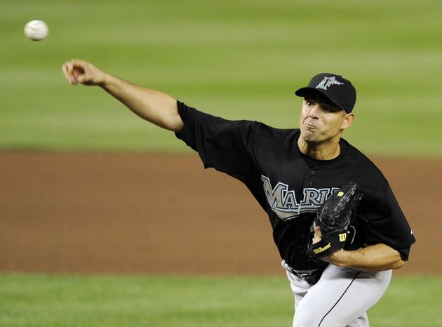 Florida Marlins starting pitcher Javier Vazquez pitched a complete-game shutout against the Washington Nationals on Friday. He struck out seven and allowed five hits. The Marlins won 3-0. (AP Photo/Nick Wass)