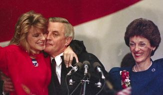 ** FILE ** In this Nov. 7, 1984, file photo, Walter Mondale is hugged by his daughter Eleanor as his wife Joan looks on at the St. Paul Civic Center in St. Paul, Minn., where Mondale conceded the presidential race to Ronald Reagan. Eleanor Mondale died at her home in Minnesota, Saturday, Sept. 17, 2011, according to a family spokesperson. (AP Photo/Jim Mone, File)