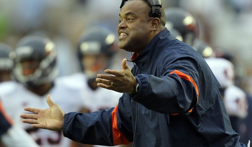 Virginia coach Mike London directs his team during the second half of an NCAA college football game against North Carolina in Chapel Hill, N.C. on Saturday, Sept. 17, 2011. North Carolina won 28-17. (AP Photo/Gerry Broome)