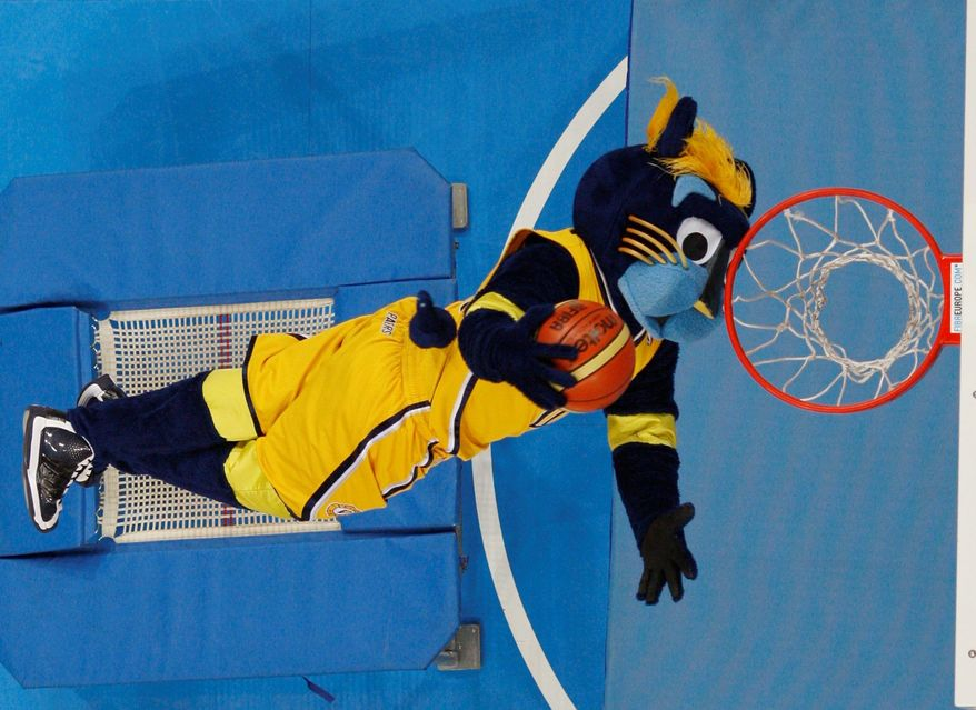 The Indiana Pacers' mascot provide s entertainment at the Eurobasket tournament with a dunking exhibition. (Associated Press)