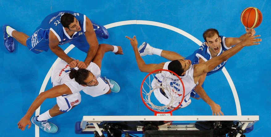 Nick Calathes of Greece (right) releases a shot over France's Nicolas Batum at the EuroBasket tournament in Kaunas, Lithuania. (Associated Press)