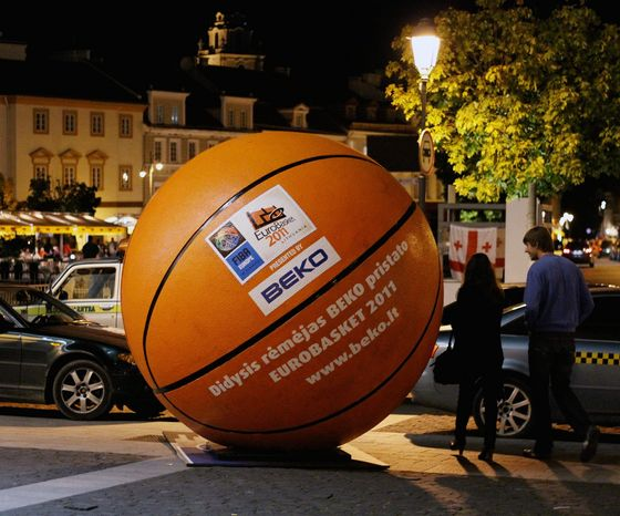 In Vilnius, a giant basketball dwarfs cars and people in a large open square in the city's ancient old town. (Christopher Johnson/Special to The Washington Times)