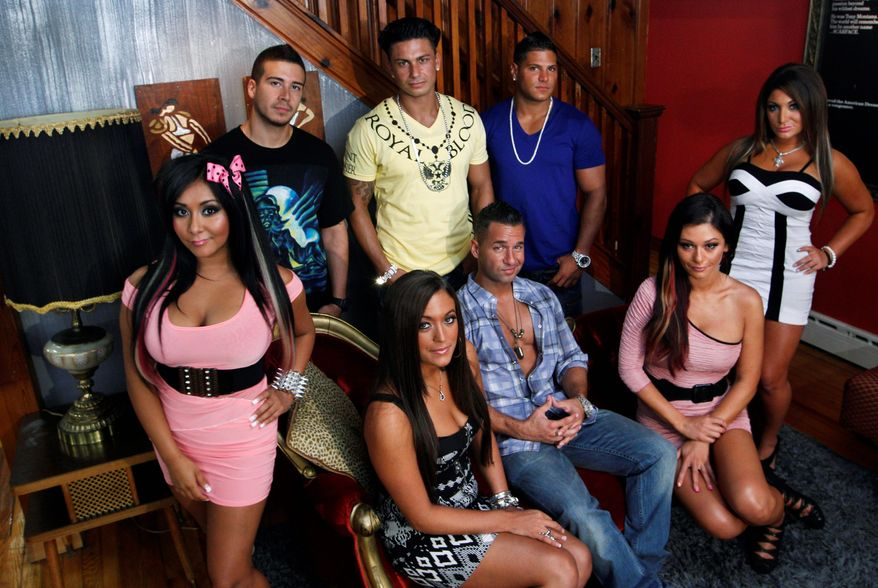 """Cast members of MTV's """"Jersey Shore"""" pose at their television home in Seaside Heights, N.J. The New Jersey state Economic Development Authority approved covering $420,000 of the production costs for the reality series' inaugural 2009 season. (Associated Press)"""