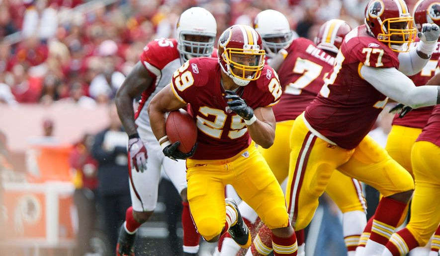 Redskins running back Roy Helu (29) takes off on a 33-yard run after catching a Rex Grossman pass in the second quarter to set up a touchdown against the Arizona Cardinals at FedEx Field in Landover, Md., on Sunday, September 18, 2011. (T.J. Kirkpatrick/The Washington Times)