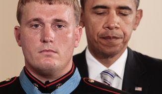 President Obama awards the Medal of Honor to former Marine Dakota Meyer on Sept. 15, 2011. (Associated Press) ** FILE **