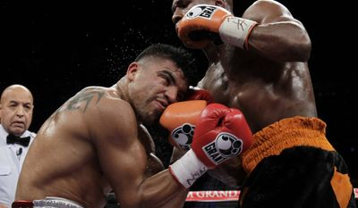 Floyd Mayweather Jr., right, punches Victor Ortiz during during their WBC welterweight title fight Saturday, Sept. 17, 2011, in Las Vegas. (AP Photo/Julie Jacobson)