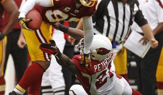 Washington Redskins wide receiver Santana Moss (89) tries to run past Arizona Cardinals cornerback Patrick Peterson in the second half of an NFL football game in Landover, Md., Sunday, Sept. 18, 2011. Washington won 22-21. (AP Photo/Evan Vucci)