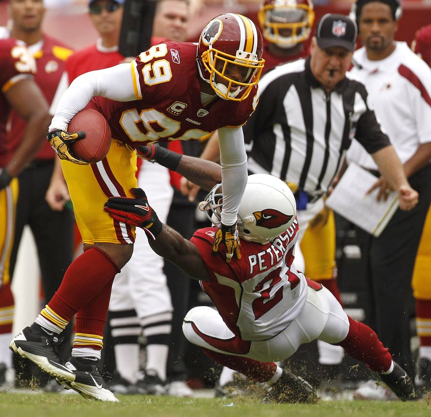 Washington Redskins wide receiver Santana Moss (89) tries to run past Arizona Cardinals cornerback Patrick Peterson in the second half of an NFL football game in Landover, Md., Sunday, Sept. 18, 2011. Washington won 22-21. (AP Photo/Evan Vucci)