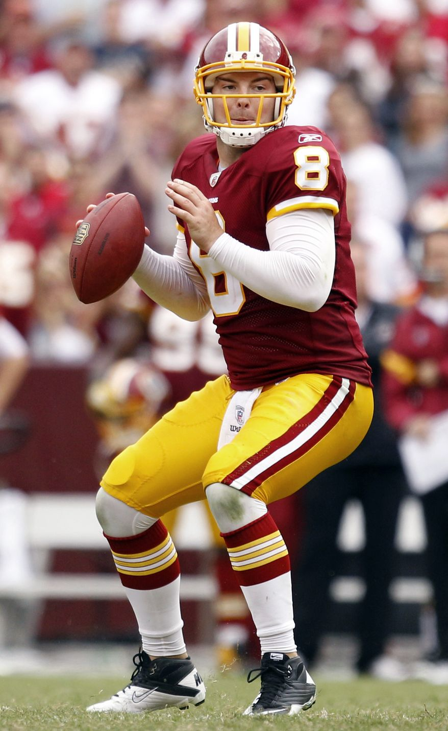 Washington Redskins quarterback Rex Grossman looks for a receiver in the second half of an NFL football game against the Arizona Cardinals in Landover, Md., Sunday, Sept. 18, 2011. (AP Photo/Evan Vucci)