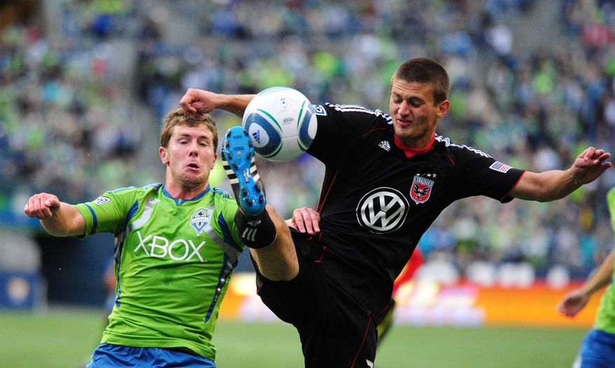 Sounders FC forward Mike Fucito, left, fights for the ball against DC United's Perry Kitchen in the first half at CenturyLink Field on Saturday, Sept. 17, 2011, in Seattle, Wash. United lost 3-0. (AP Photo/The Seattle Times, John Lok)