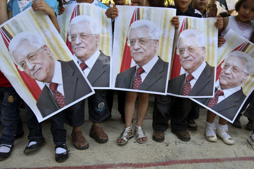 Palestinian children hold posters of Palestinian President Mahmoud Abbas during a rally in the village of Azmut, near the West Bank city of Nablus, on Sunday, Sept. 18, 2011. Mr. Abbas is set to address the United Nations this week to ask the world to recognize a Palestinian state. (AP Photo/Nasser Ishtayeh)