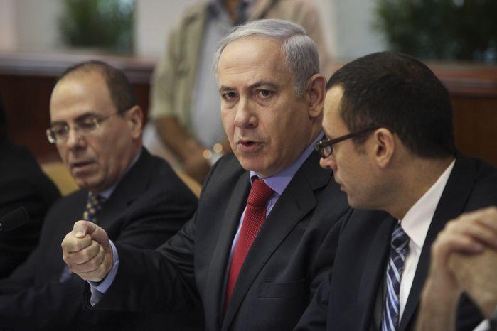** FILE ** Israeli Prime Minister Benjamin Netanyahu (center) speaks during a weekly Cabinet meeting in Jerusalem on Sunday, Sept. 18, 2011. Also attending are Cabinet Secretary Zvi Houser (right) and Deputy Prime Minister Silvan Shalom (left). (AP Photo/Tara Todras-Whitehill, Pool)