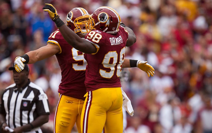 Washington Redskins linebackers Brian Orakpo (98) and Ryan Kerrigan (91) chest-bump after the Redskins recovered a fumble during the fourth quarter of the game with the Arizona Cardinals at FedEx Field in Landover, Md., on Sunday, Sept. 18, 2011. (Pratik Shah/The Washington Times)