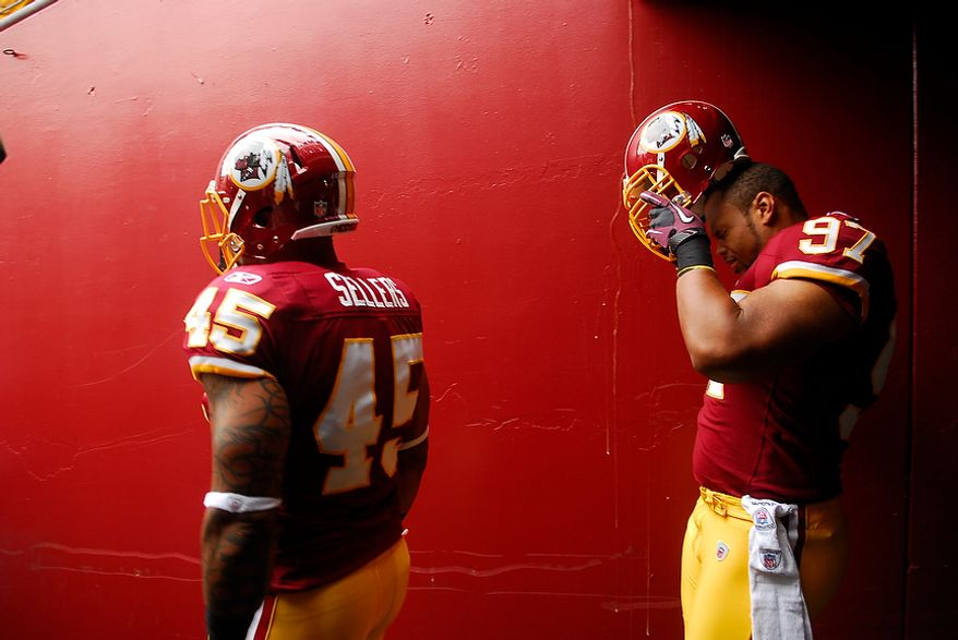 Washington Redskins tight end Mike Sellers (45) and linebacker Lorenzon Alexander (97) prepare to take the field for a game with the Arizona Cardinals at FedEx Field in Landover, Md., on Sunday, Sept. 18, 2011. (Andrew Harnik/The Washington Times)
