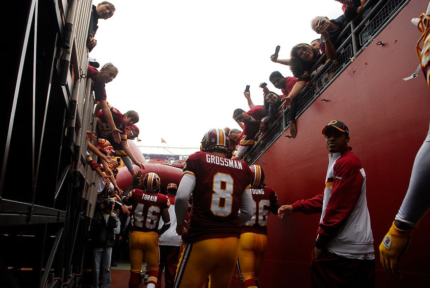 Washington Redskins quarterback Rex Grossman heads onto the field to face the Arizona Cardinals at FedEx Field in Landover, Md., on Sunday, Sept. 18, 2011. (Andrew Harnik/The Washington Times)