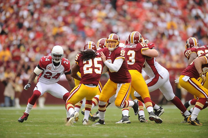 Washington Redskins quarterback Rex Grossman runs into running back Tim Hightower on a handoff during the opening drive of the first quarter against the Arizona Cardinals at FedEx Field in Landover, Md., on Sunday, Sept. 18, 2011. (Andrew Harnik/The Washington Times)