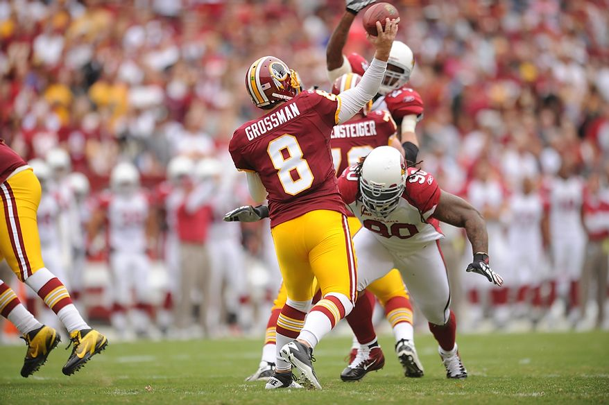 Washington Redskins quarterback Rex Grossman passes during the opening drive of the first quarter against the Arizona Cardinals at FedEx Field in Landover, Md., on Sunday, Sept. 18, 2011. (Andrew Harnik/The Washington Times)