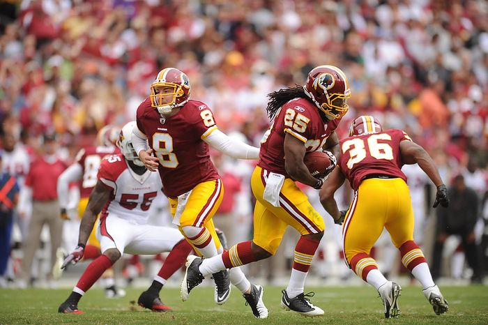 Washington Redskins quarterback Rex Grossman hands off to running back Tim Hightower during the second drive of the first quarter of a game with the Arizona Cardinals at FedEx Field in Landover, Md., on Sunday, Sept. 18, 2011. (Andrew Harnik/The Washington Times)