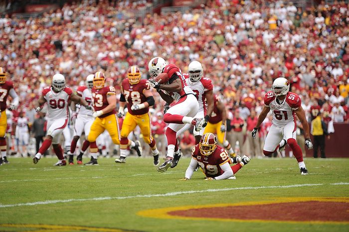 The Washington Redskins' first drive is halted as quarterback Rex Grossman's pass is picked off by Arizona Cardinals strong safety Adrian Wilson (24) at the Arizona 6-yard line for Grossman's first interception in the first quarter at FedEx Field in Landover, Md., on Sunday, Sept. 18, 2011. (Andrew Harnik/The Washington Times)