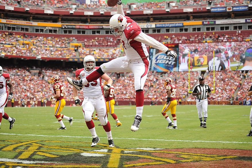 The Arizona Cardinals celebrate quarterback Kevin Kolb's (not shown) 21-yard touchdown pass to tight end Jeff King (foreground) during the first quarter of their game with the Washington Redskins at FedEx Field in Landover, Md., on Sunday, Sept. 18, 2011. (Andrew Harnik/The Washington Times)