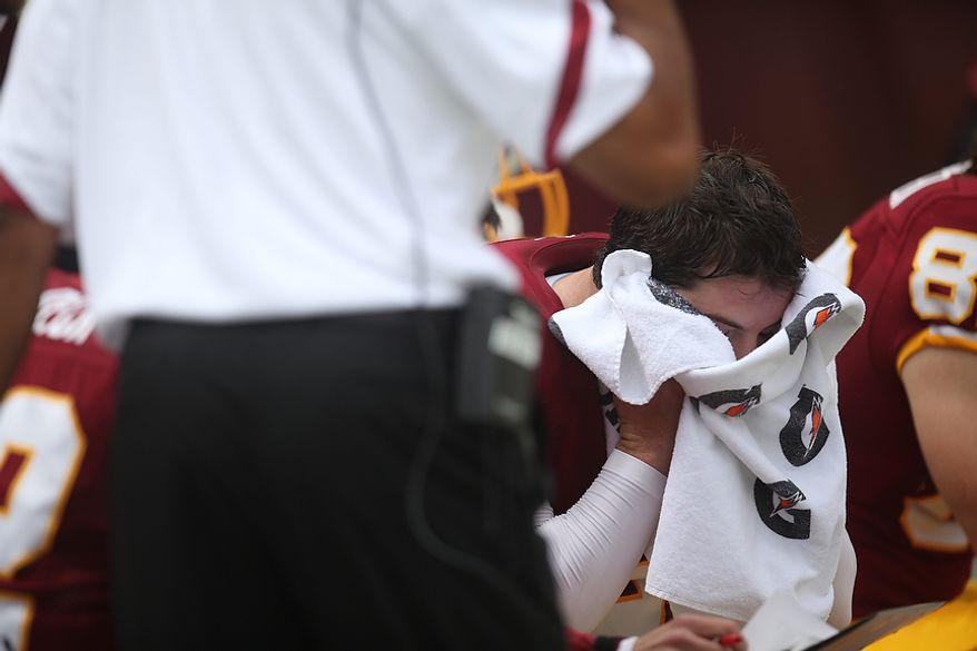 Redskins' quarterback Rex Grossman shows his frustration after being intercepted at the Arizona 6-yard line by the Arizona Cardinals' strong safety Adrian Wilson to kill the Redskins' first drive of the game at FedEx Field in Landover, Md., on Sunday, September 18, 2011. (Pratik Shah/The Washington Times)
