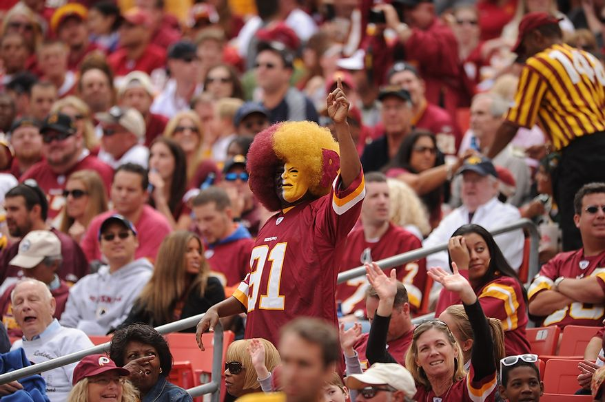 A Redskins' fan cheers during the first quarter against the Arizona Cardinals at FedEx Field in Landover, Md., on Sunday, September 18, 2011. (Andrew Harnik/The Washington Times)