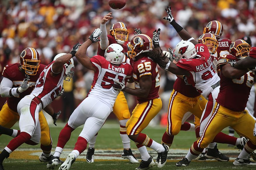The Arizona Cardinals rush Redskins' quarterback Rex Grossman during the first quarter at FedEx Field in Landover, Md., on Sunday, September 18, 2011. (Pratik Shah/The Washington Times)